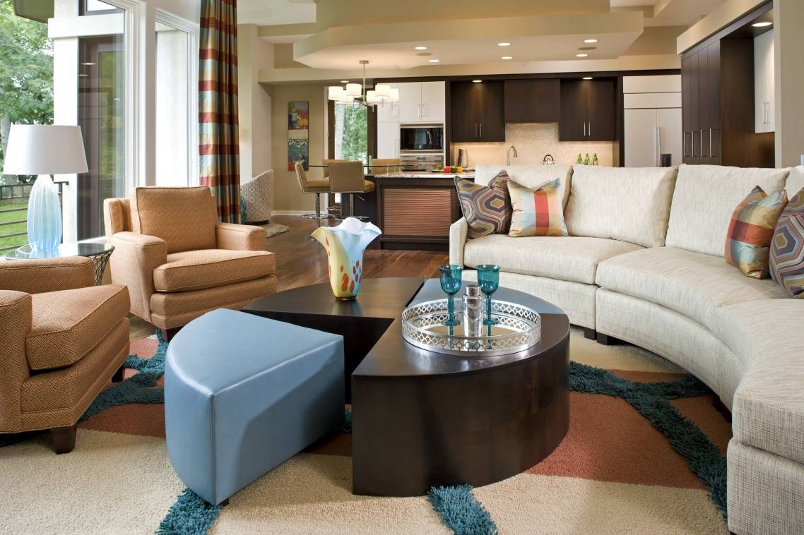 Modern Beige Circular Sectional Sofa Bed With Pillows In Front Of Throughout Half Moon Sectional Sofas (View 9 of 15)