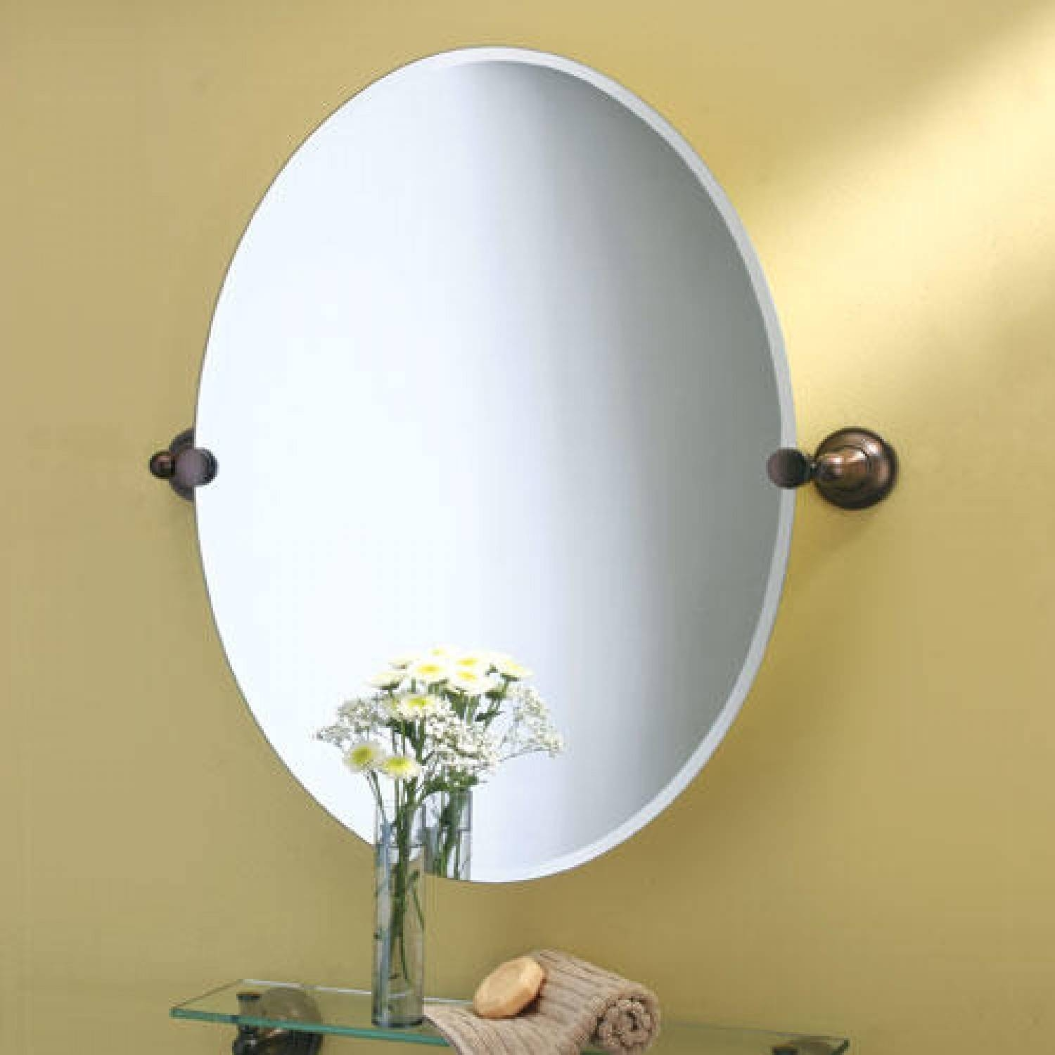 Oval Bathroom Mirror With Double Brown Metal Hook On Cream Wall pertaining to Oval Cream Mirrors (Image 11 of 15)