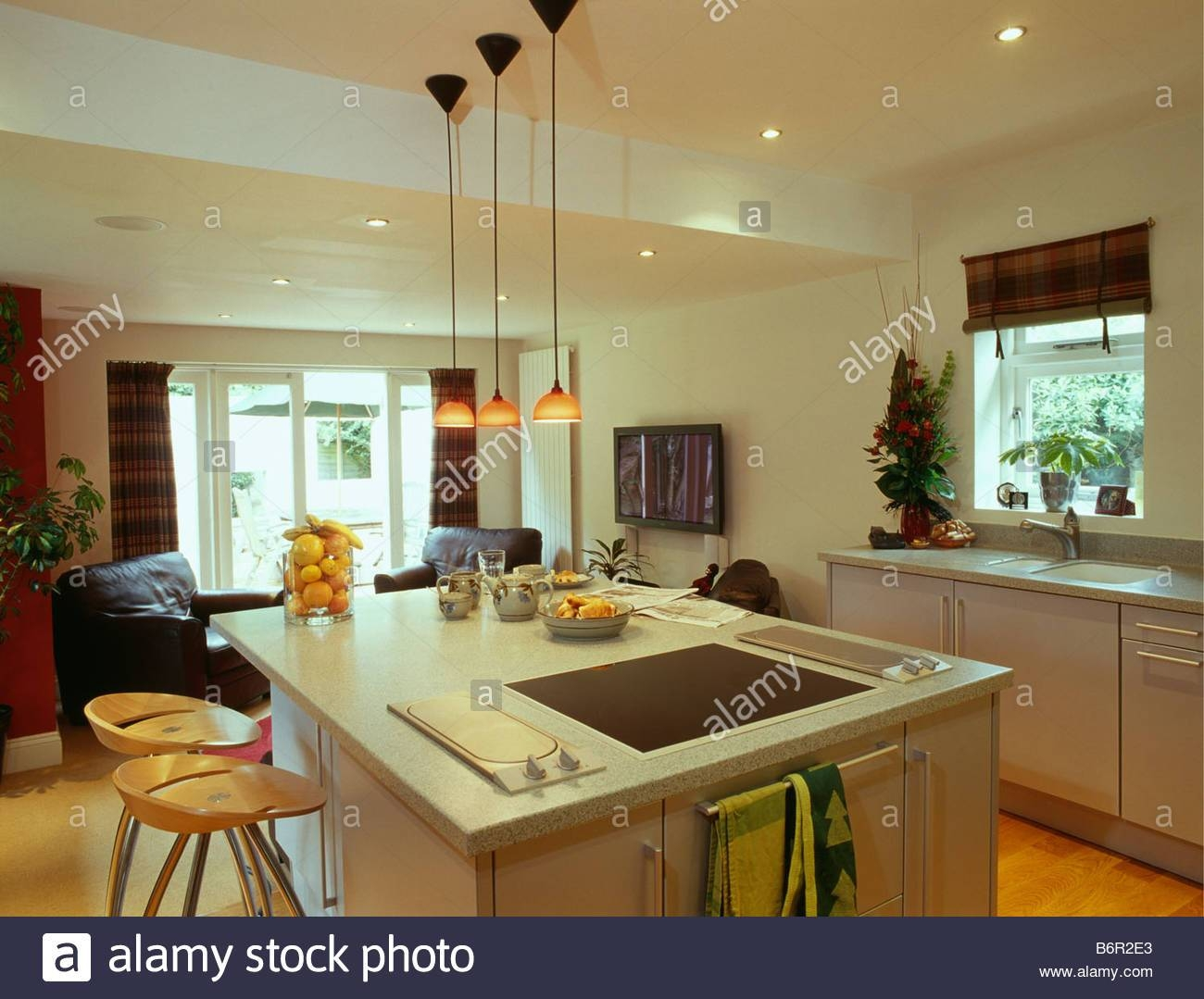Pendant Lights In Kitchen Stock Photos & Pendant Lights In Kitchen Inside Orange Pendant Lights For Kitchen (View 5 of 15)