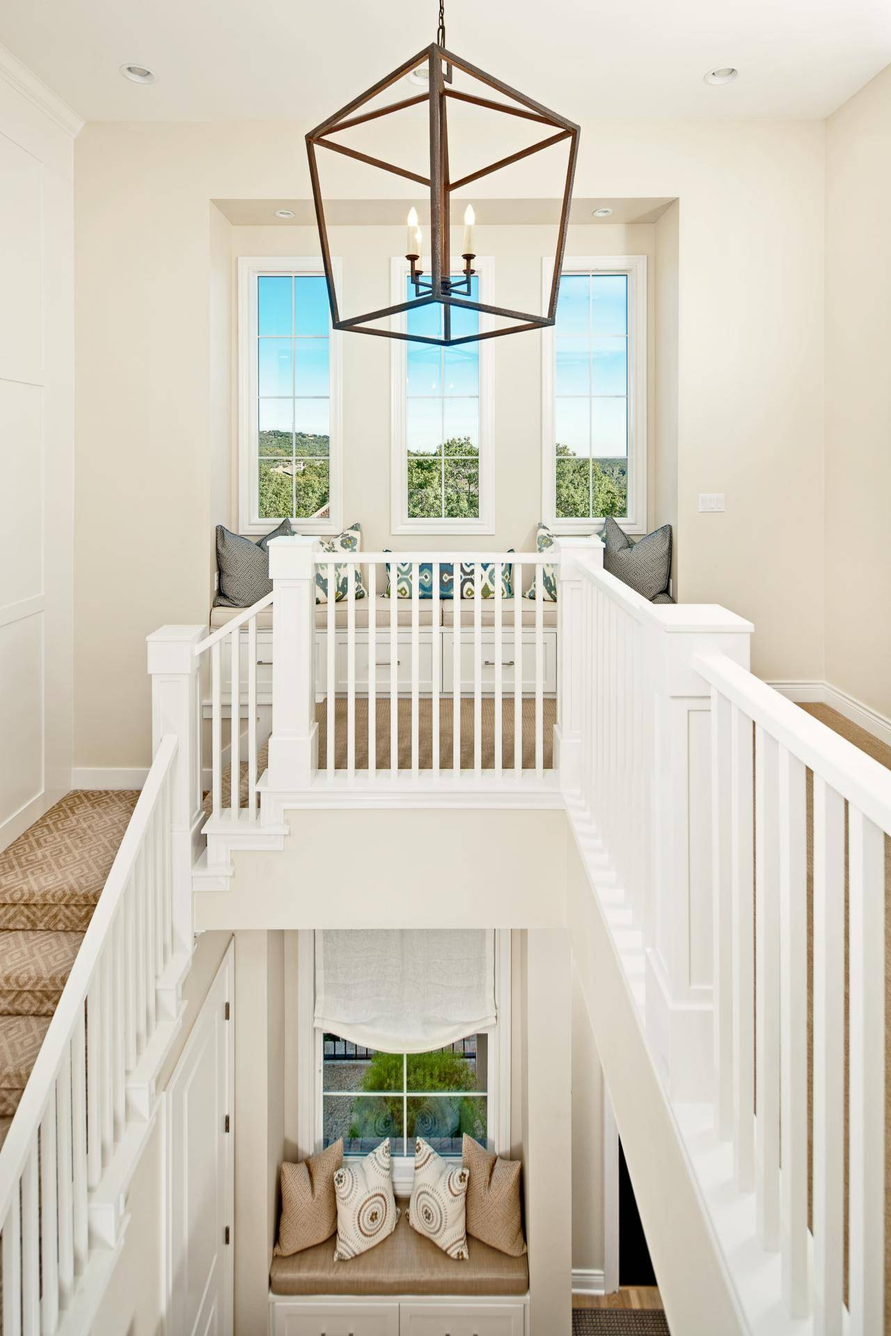 White Stairwell With A Classic Modern Pendant Light And Window with regard to Pendant Lights Stairwell (Image 15 of 15)