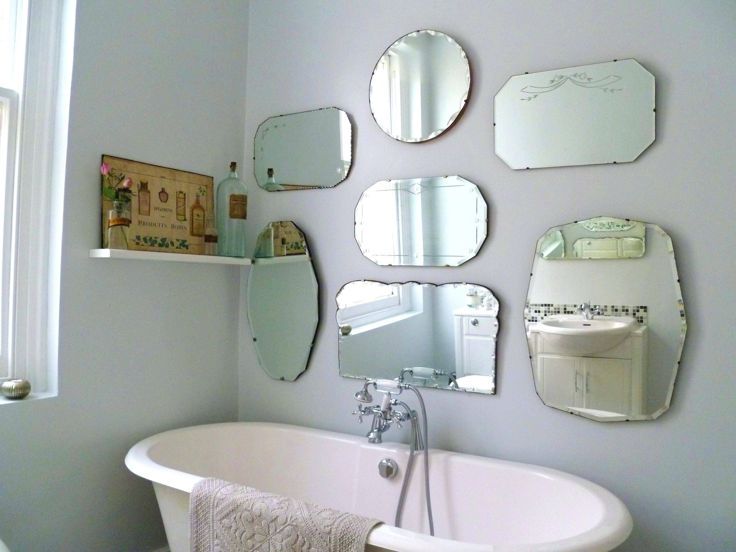 White Vintage Bathroom Design With Large Crystal Chandelier And for Old-Style Mirrors (Image 15 of 15)