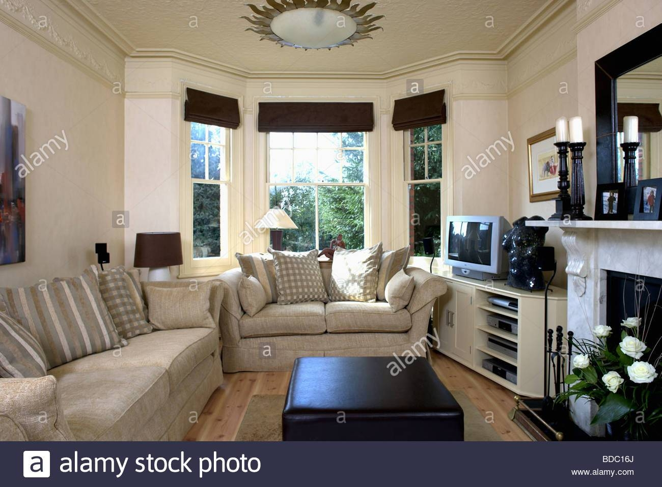 Beige Sofas In Cream Living Room With Black Blinds On Bay Window pertaining to Bay Window Sofas (Image 5 of 15)