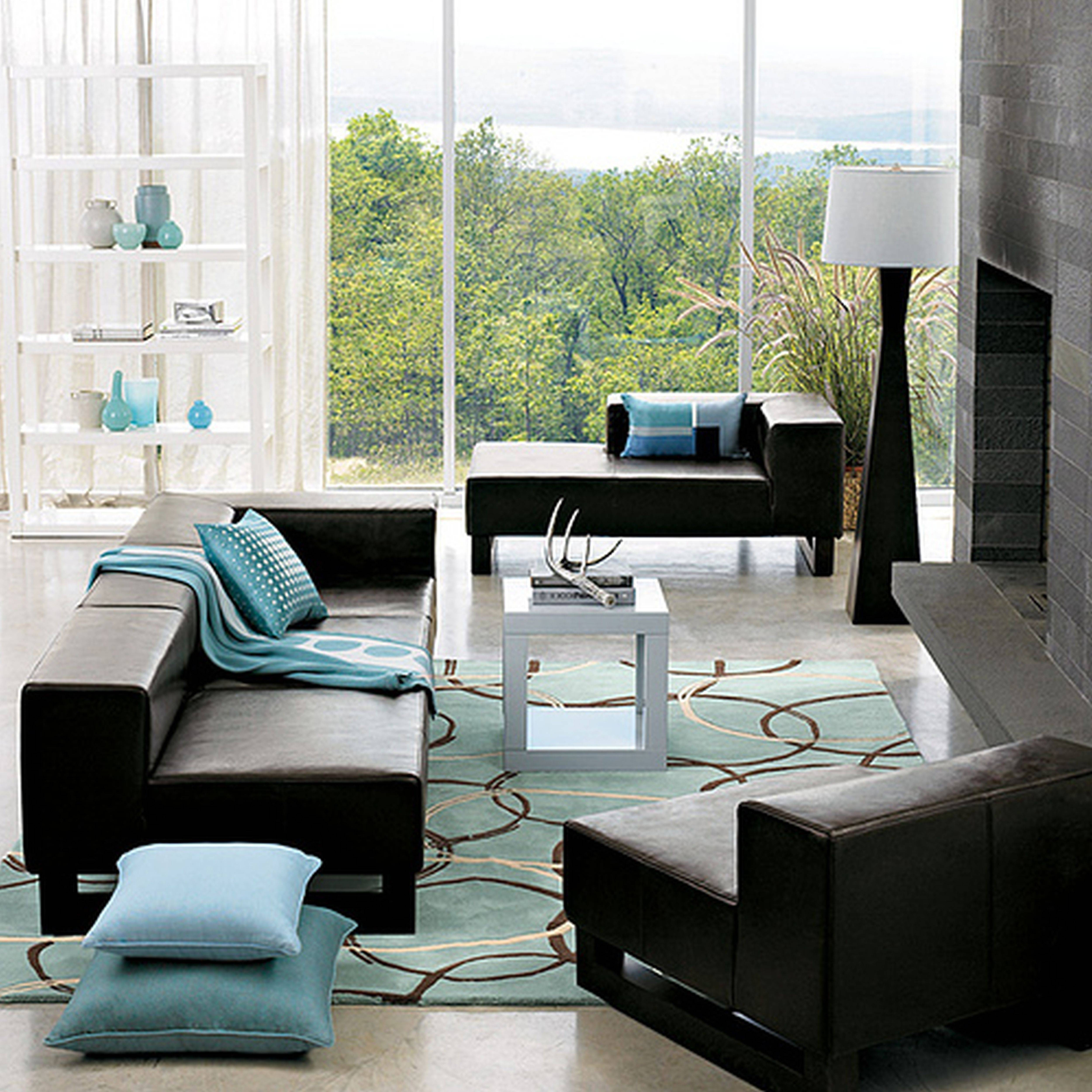 Black Leather Couch With Blue Blanket And Cushions Combined with regard to Black Sofas Decors (Image 6 of 15)