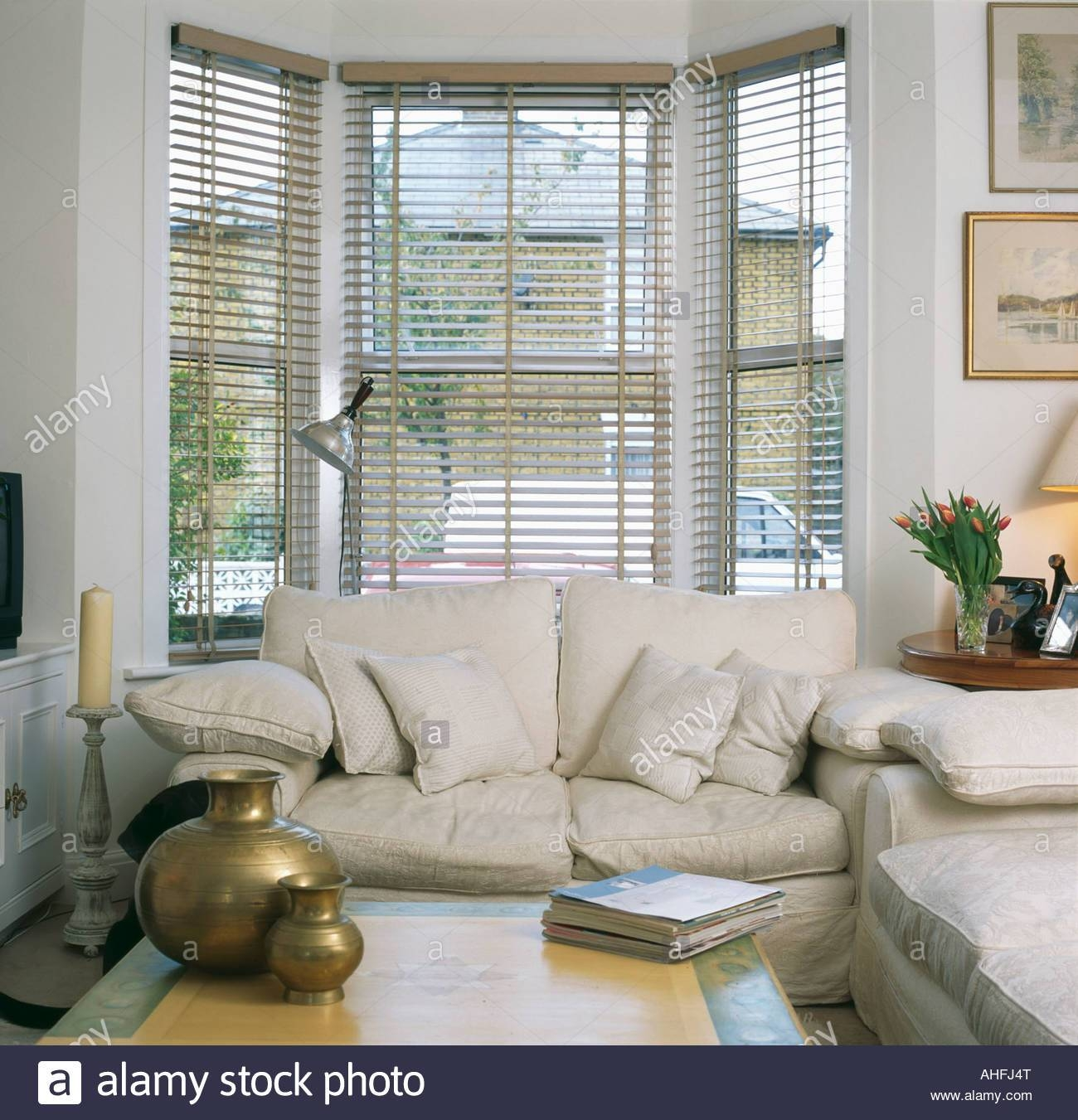 Cream Sofa In Front Of Bay Window With Slatted Blind In Living throughout Bay Window Sofas (Image 6 of 15)