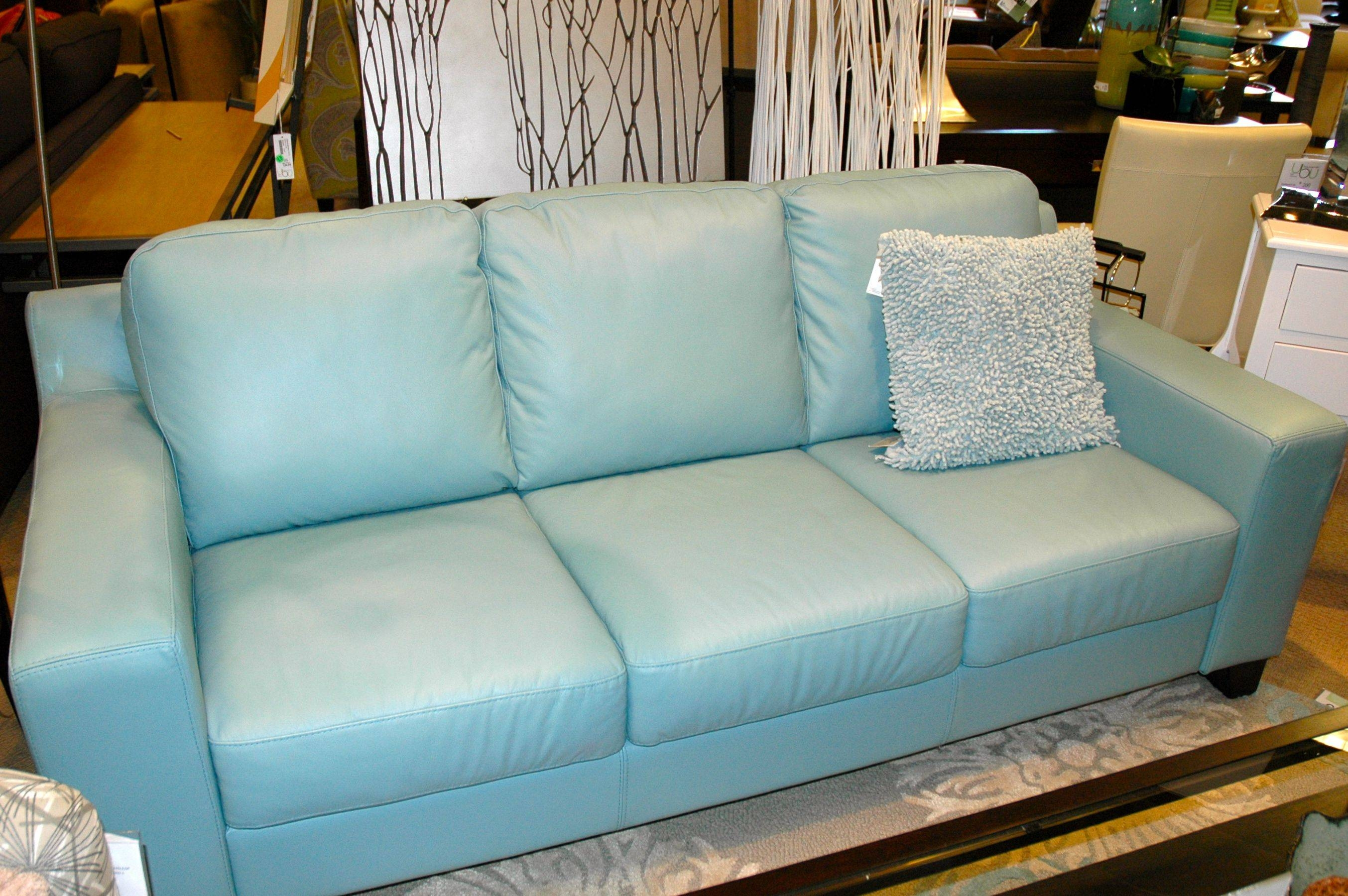 Cute Light Blue Cushion Placed On Comfortable Blue Leather Sofa At in Sky Blue Sofas (Image 5 of 15)
