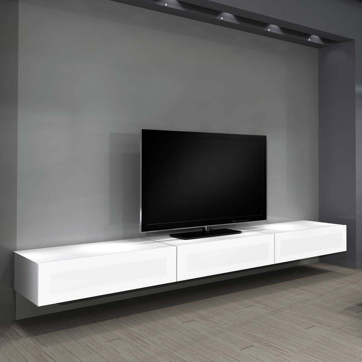 Floating Long White Wooden Cabinet With Tv On The Top Placed On inside Long White Tv Cabinets (Image 9 of 15)