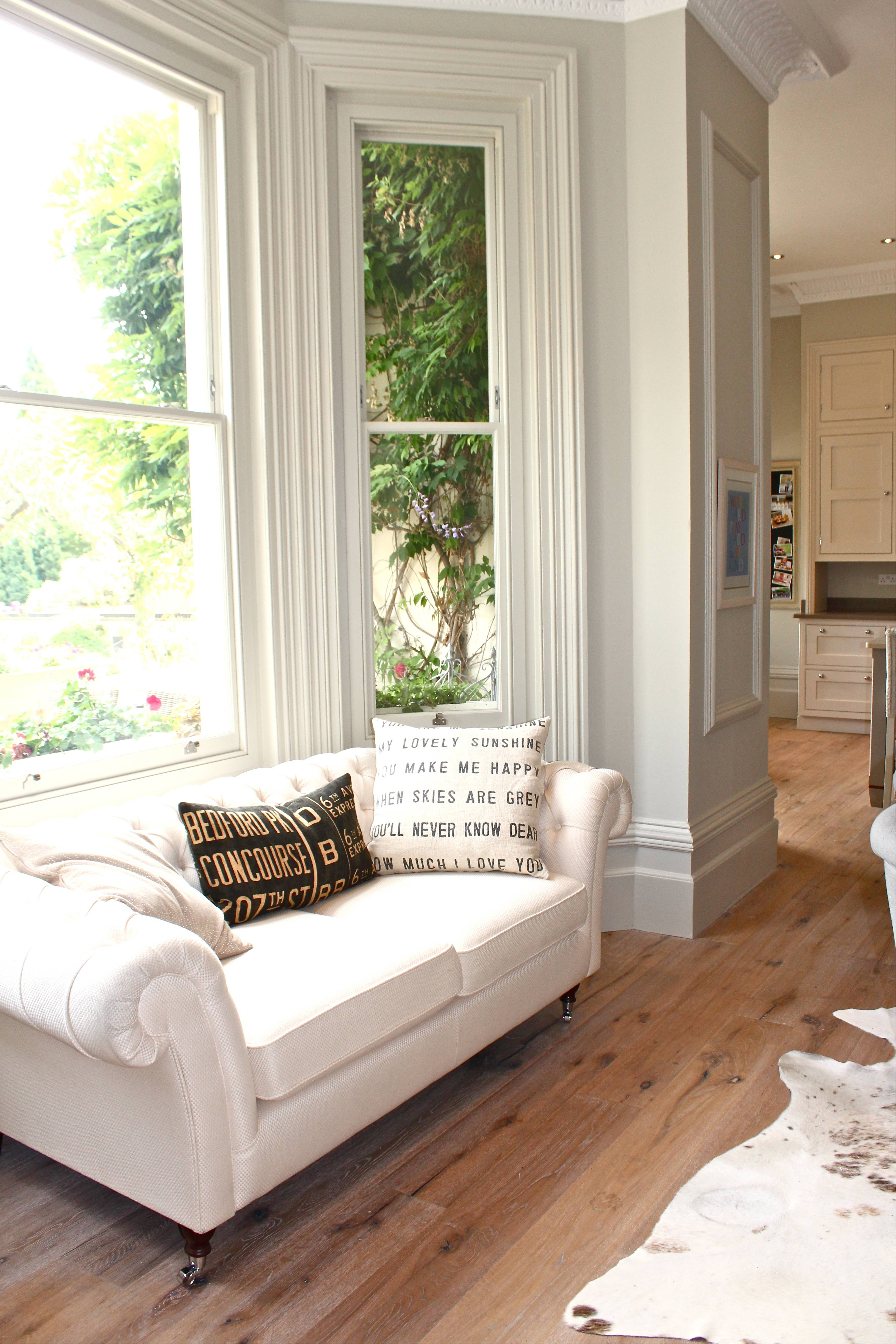 Large Japanese Paper Lantern Above White Sofa And Bay Window Sofas Within Sofas For Bay Window (View 11 of 15)