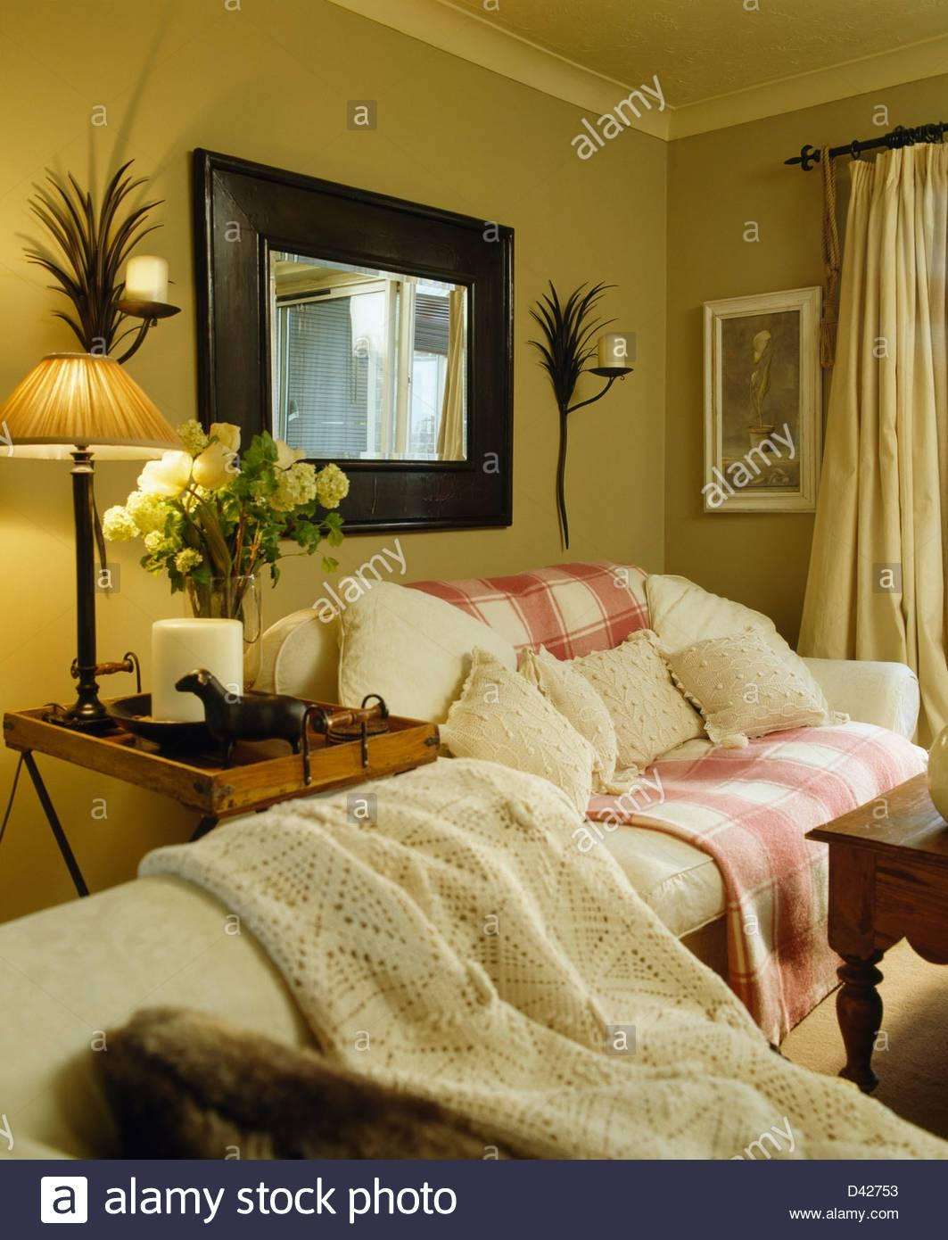Large Mirror Above Cream Sofa With Pink+White Throw In Ochre regarding Mirror Above Sofas (Image 6 of 15)