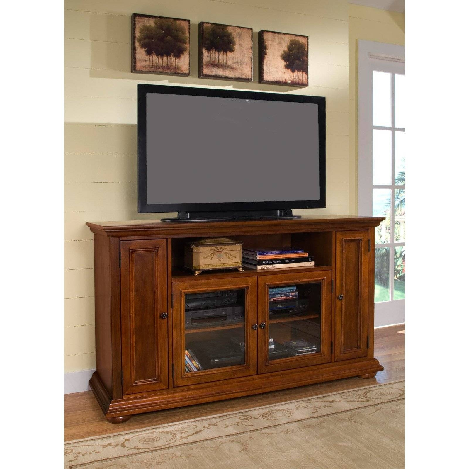 Rectangle Black Flat Screen Tv Over Brown Wooden Cabinet With with regard to Wooden Tv Cabinets With Glass Doors (Image 13 of 15)