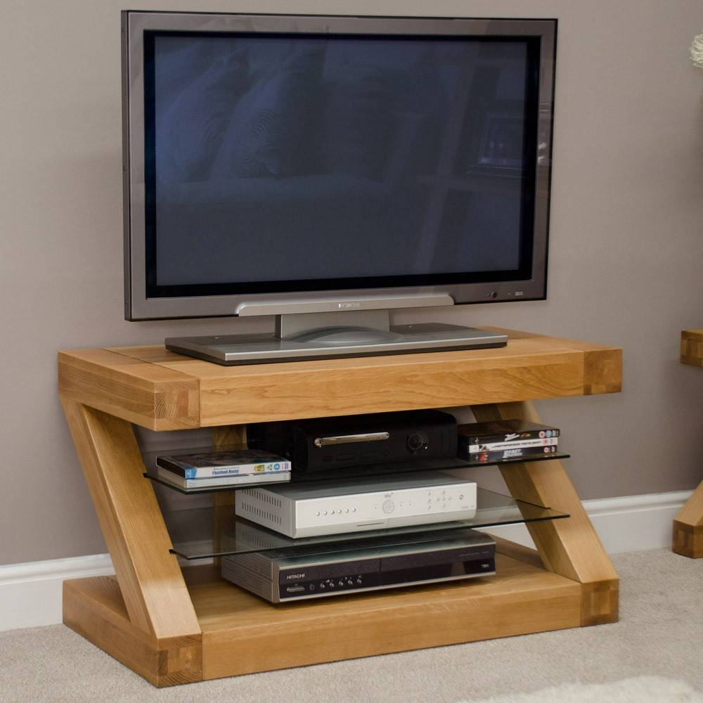 Well Turned Led Tv Above Dvd Player And Books On Glass Layer Fit with regard to Unusual Tv Cabinets (Image 14 of 15)