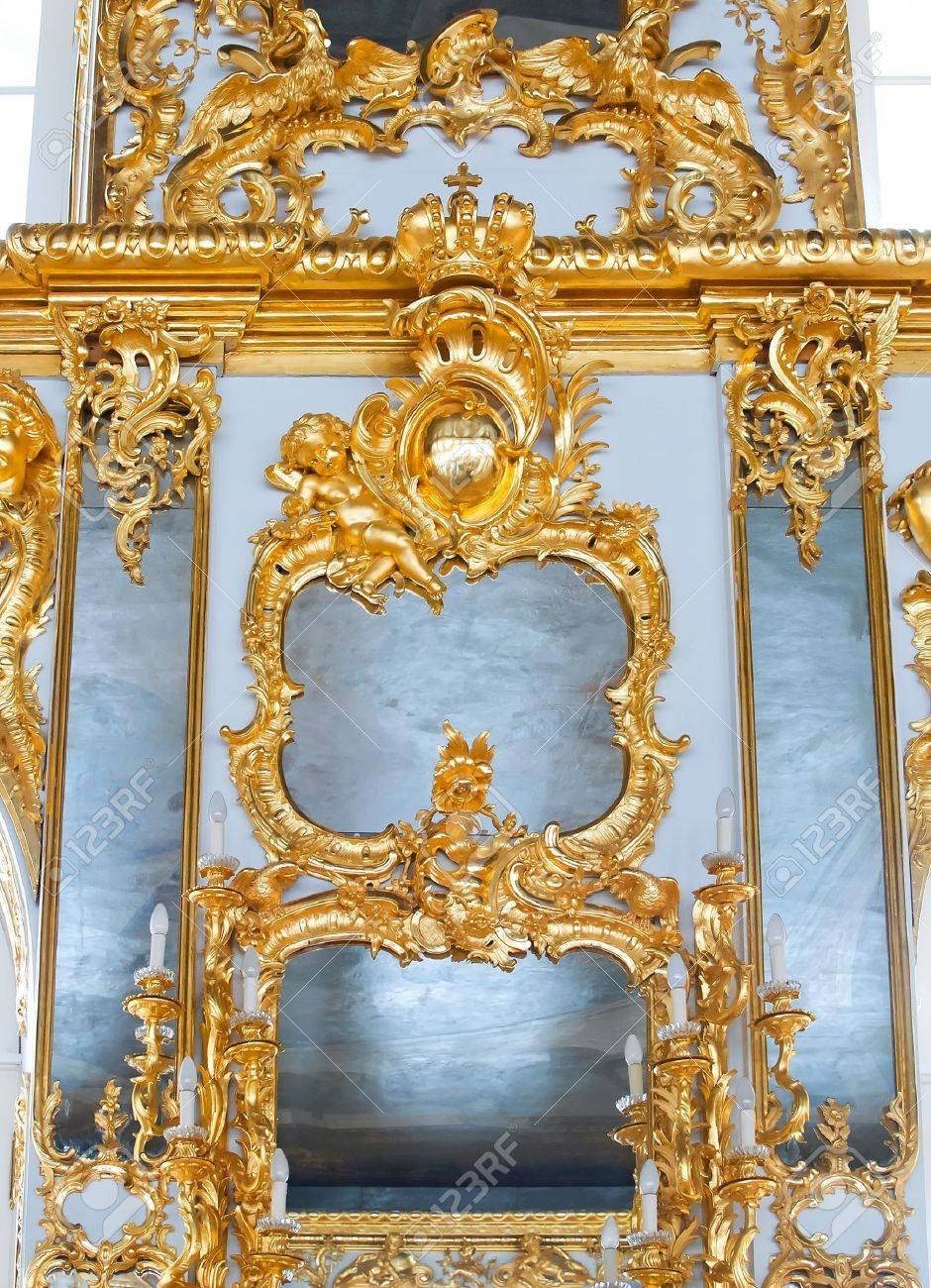 Mirrors In Frames With Golden Decorations On Wall Stock Photo with regard to Baroque Gold Mirrors (Image 13 of 15)