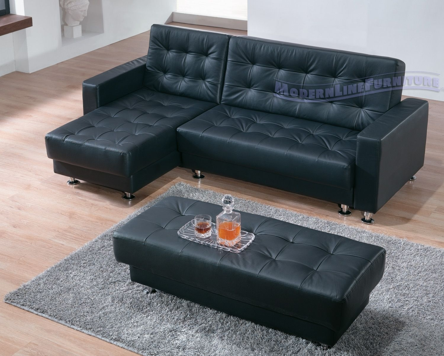 Black Leather Modern Sectional Sofa Sleeper With Ottoman | For The pertaining to Sectional Sleeper Sofas With Ottoman (Image 2 of 15)