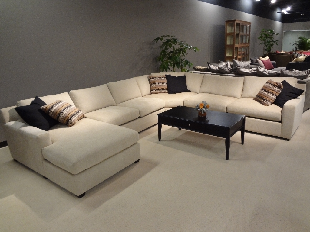 Contemporary White Tone Sleeper Couch Equipped With Rounded Coffee regarding Affordable Sectional Sofas (Image 5 of 15)