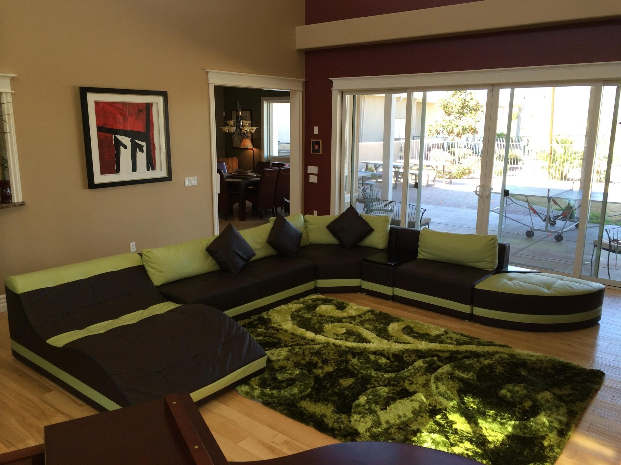 Green And Black Living Room Decor Flaunting Extra Large U Shaped within Extra Large U Shaped Sectionals (Image 10 of 15)