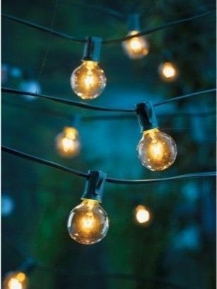 10 Ways To Fix Up Your Backyard For Under $50   Lights, Gardens And Throughout Hanging Outdoor String Lights At Target (Photo 1 of 10)