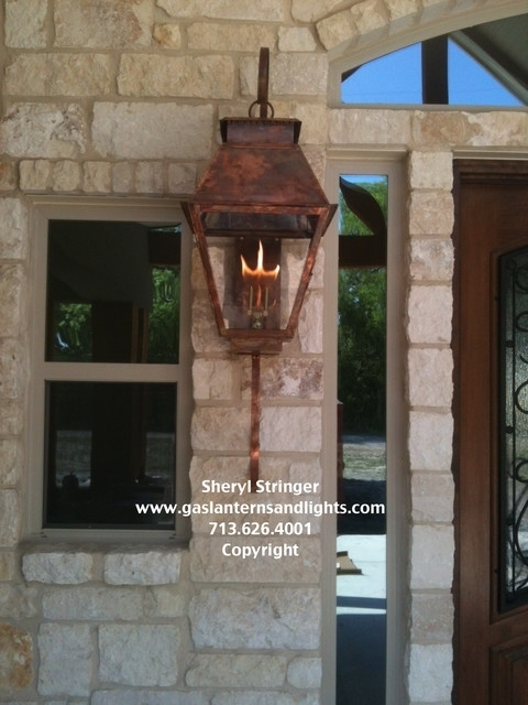 Hill Country Style Home With Gas Lanterns Traditional Houston In within Outdoor Wall Gas Lights (Image 5 of 10)