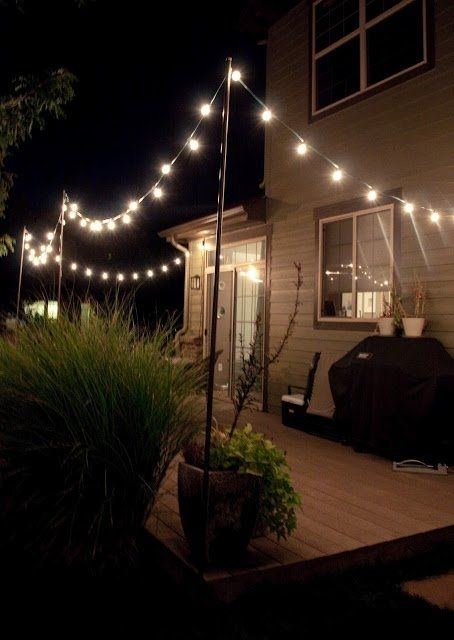 This Hack For Hanging Outdoor String Lights Will Make Your Summer within Hanging Outdoor Lights In Backyard (Image 9 of 10)