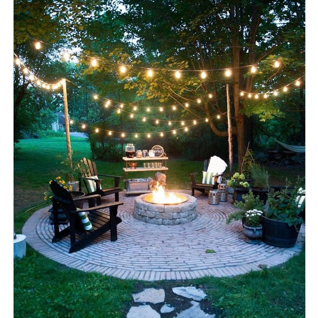 20 Dreamy Ways To Use Outdoor String Lights In Your Backyard inside Outdoor Lawn Lanterns (Image 1 of 20)