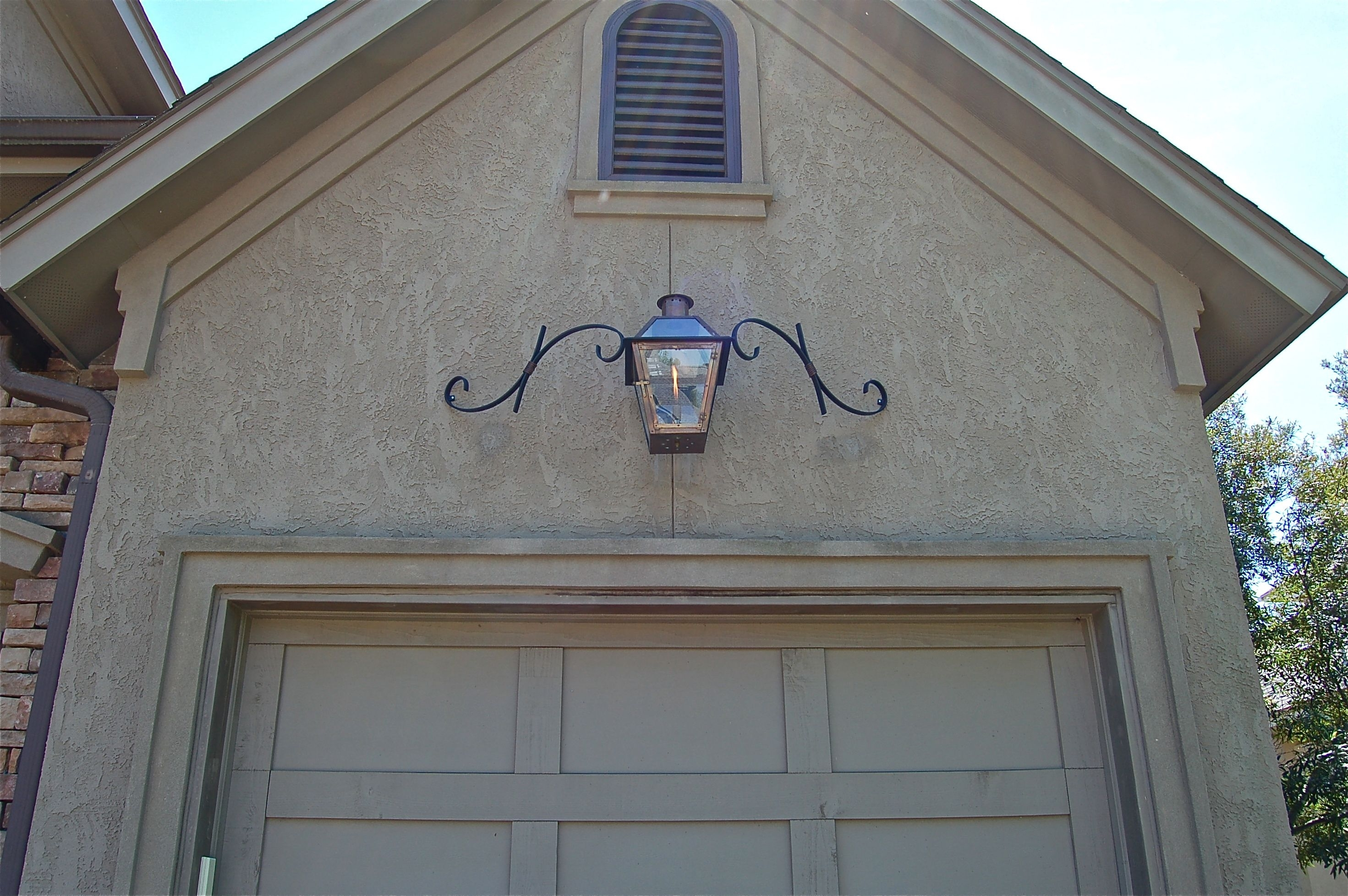 French Quarter Style Lantern With Mustache Bracket Over Garage Door Intended For Outdoor Garage Lanterns (View 20 of 20)