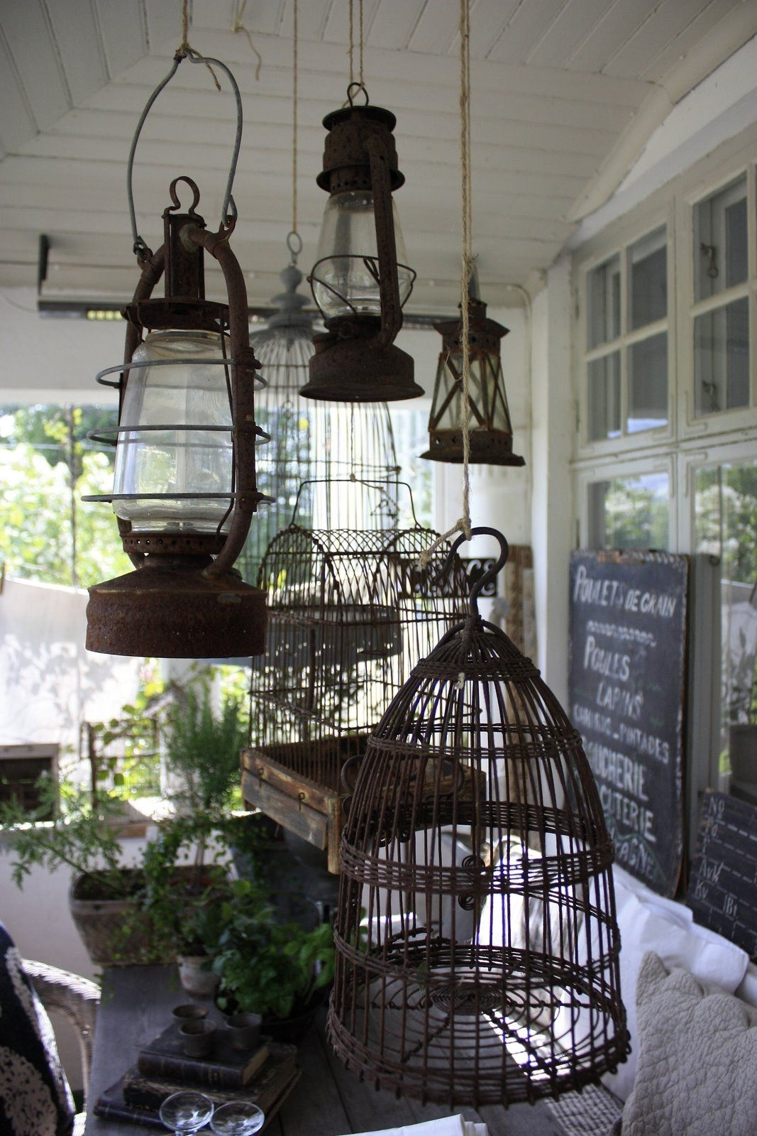 Hanging Bird Cages And Lanterns Above An Outdoor Table. | Garden throughout Outdoor Table Lanterns (Image 7 of 20)
