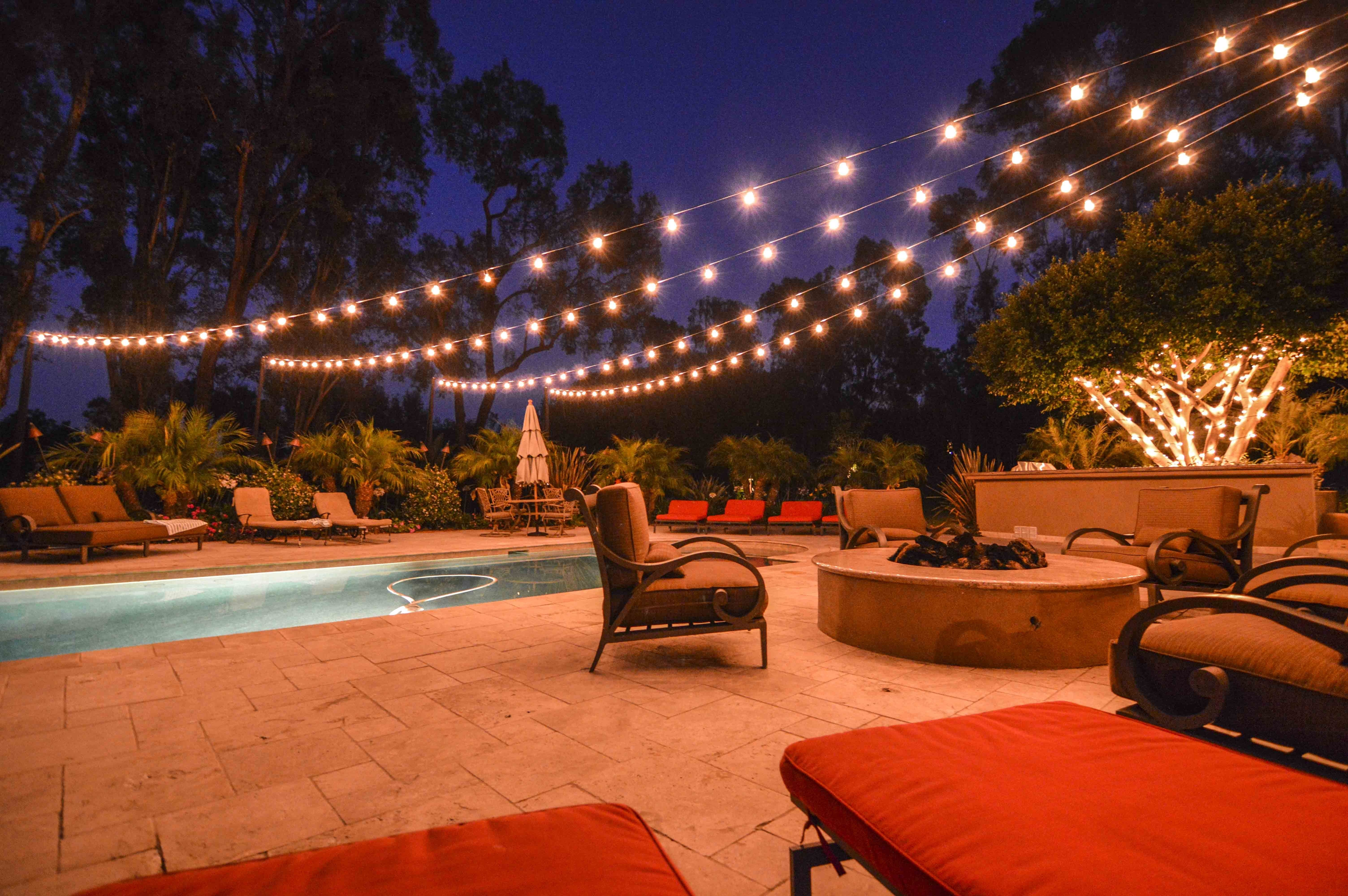 Market Lights At A Backyard Wedding In A Starburst Display Over A Within Outdoor Lanterns For Poolside (View 11 of 20)