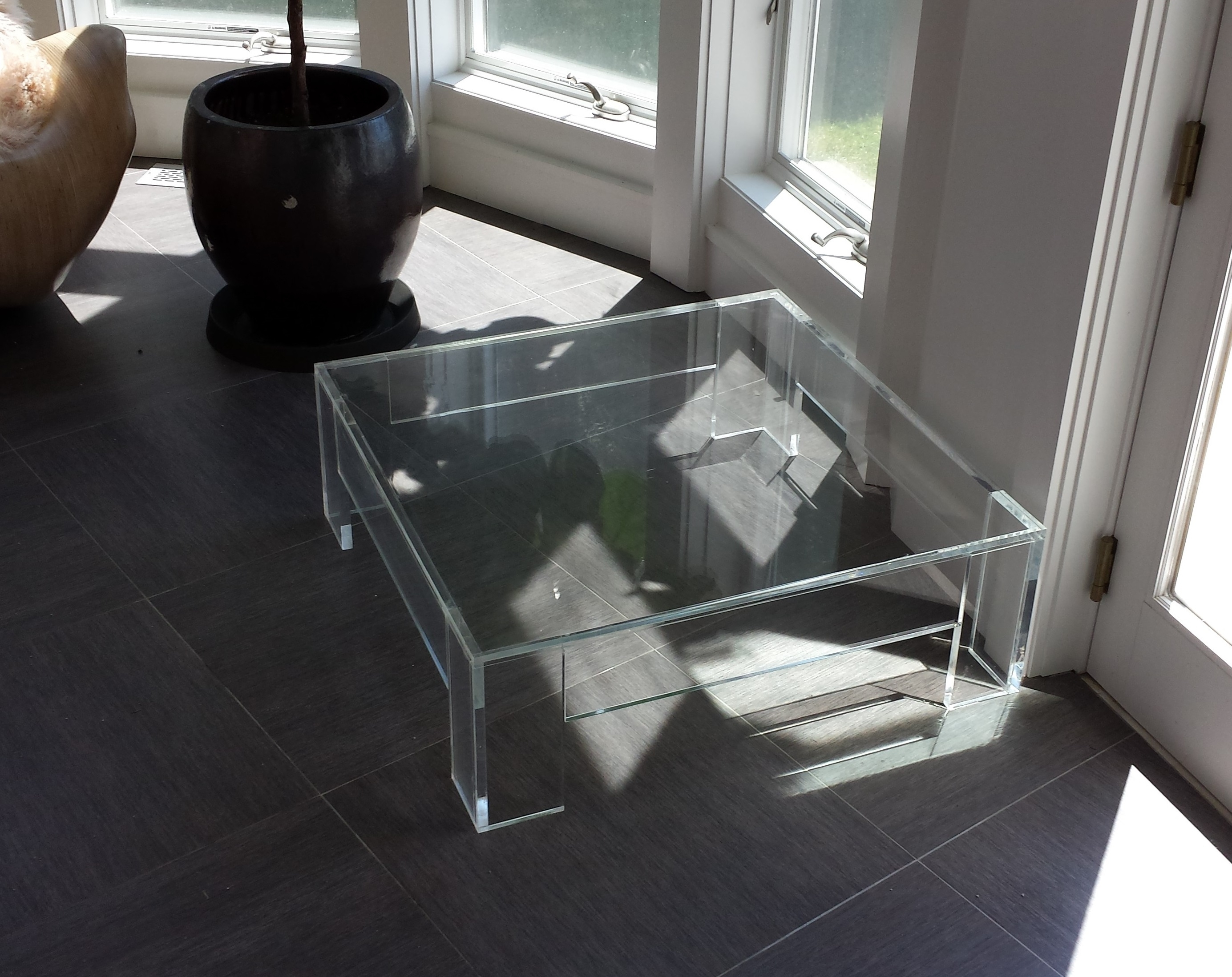 Modern Square Clear Acrylic Coffee Table With Shelf In Living Room intended for Modern Acrylic Coffee Tables (Image 25 of 30)