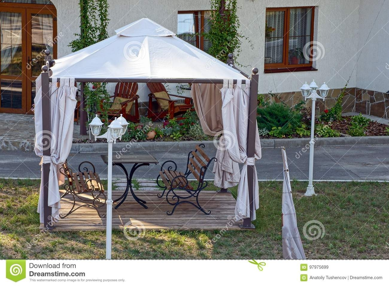 Open Gazebo With Benches On The Lawn With Lanterns Near The Road intended for Outdoor Gazebo Lanterns (Image 13 of 20)