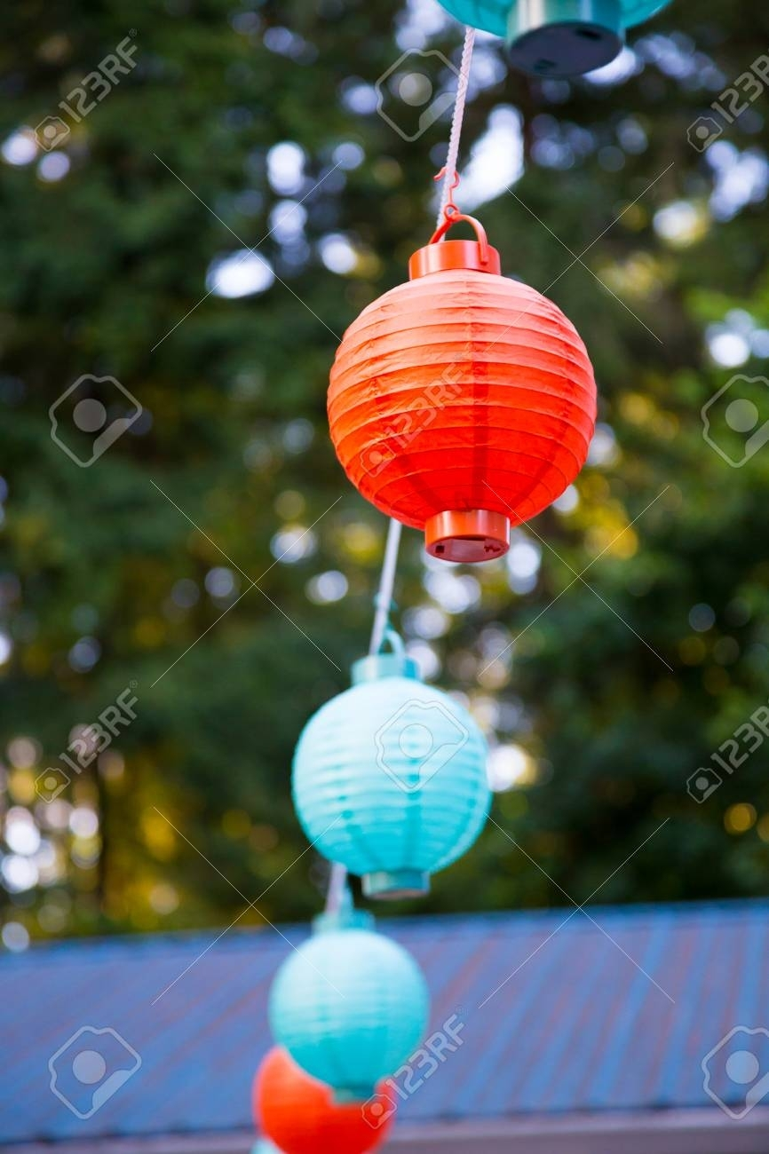 Red And Blue Paper Lanterns Hung Up High For An Outdoor Wedding throughout Outdoor Paper Lanterns (Image 17 of 20)