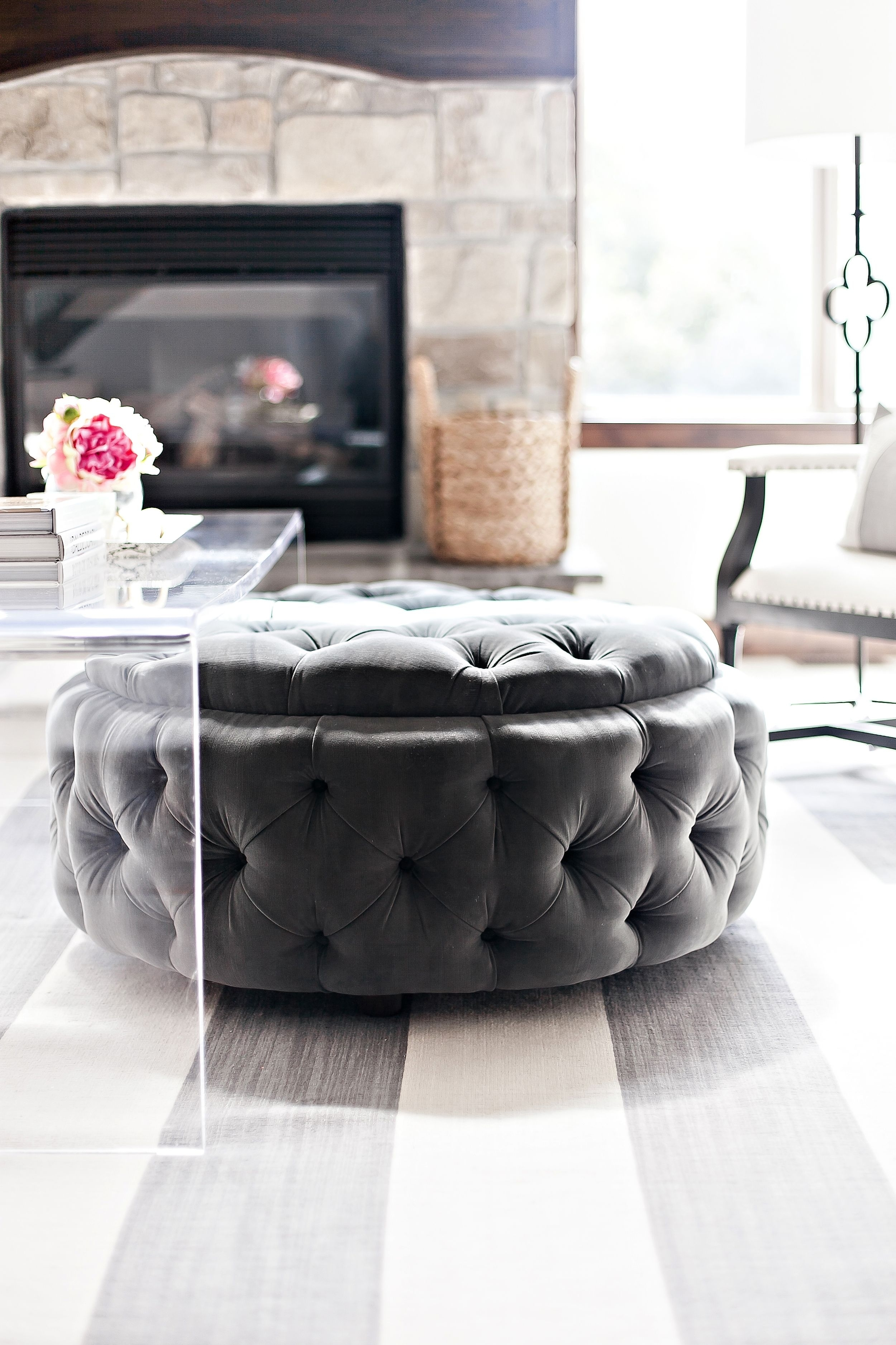 Round Upholstered Tufted Ottoman Tucked Under Acrylic Coffee Table with regard to Jelly Bean Coffee Tables (Image 26 of 30)