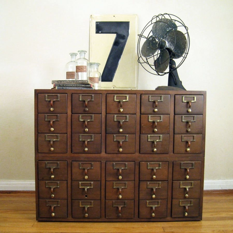 Cabinet In Peters Room/ Storage For Photos And Negatives | Finnegan with 4-Door/4-Drawer Cast Jali Sideboards (Image 3 of 30)