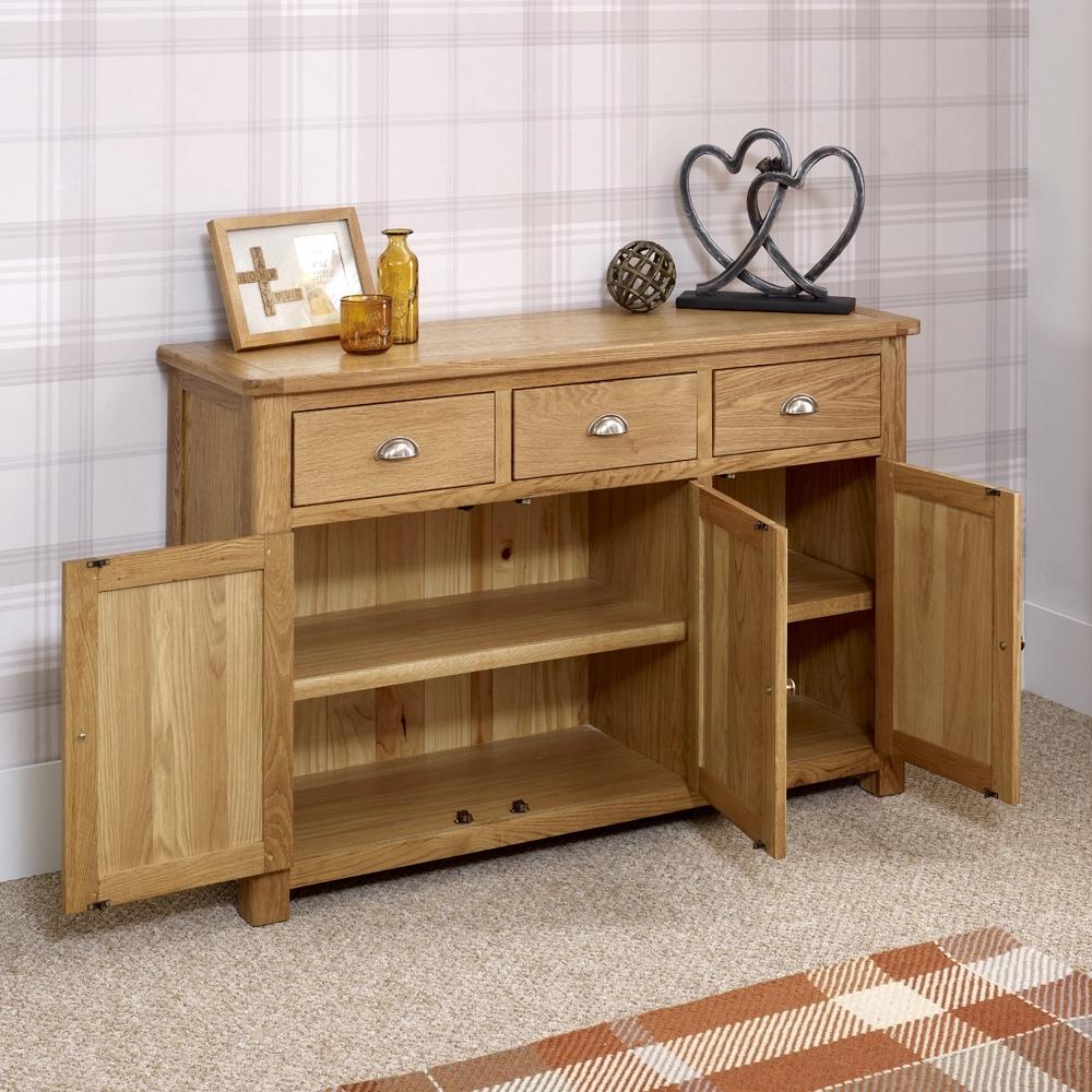 Manor Oak Large 3 Door 3 Drawer Sideboard | The Furniture Market regarding White Wash 3-Door 3-Drawer Sideboards (Image 17 of 30)