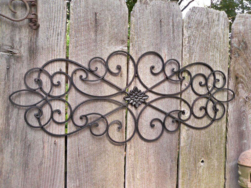 How To Outdoor Metal Wall Decor Drilling Holes In The Siding in Ornamental Wood And Metal Scroll Wall Decor (Image 14 of 30)