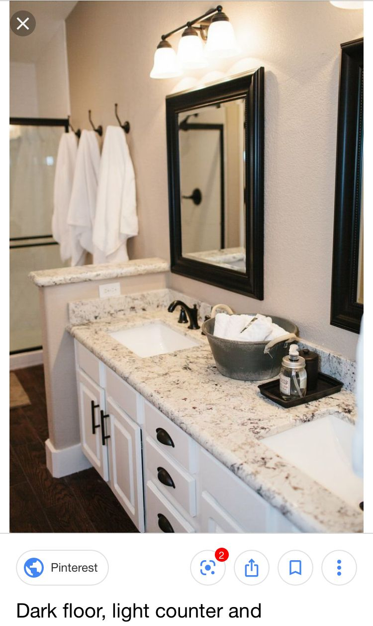 Off White Vanity With Light Countertop, Dark Trim Around The with regard to Longwood Rustic Beveled Accent Mirrors (Image 19 of 30)