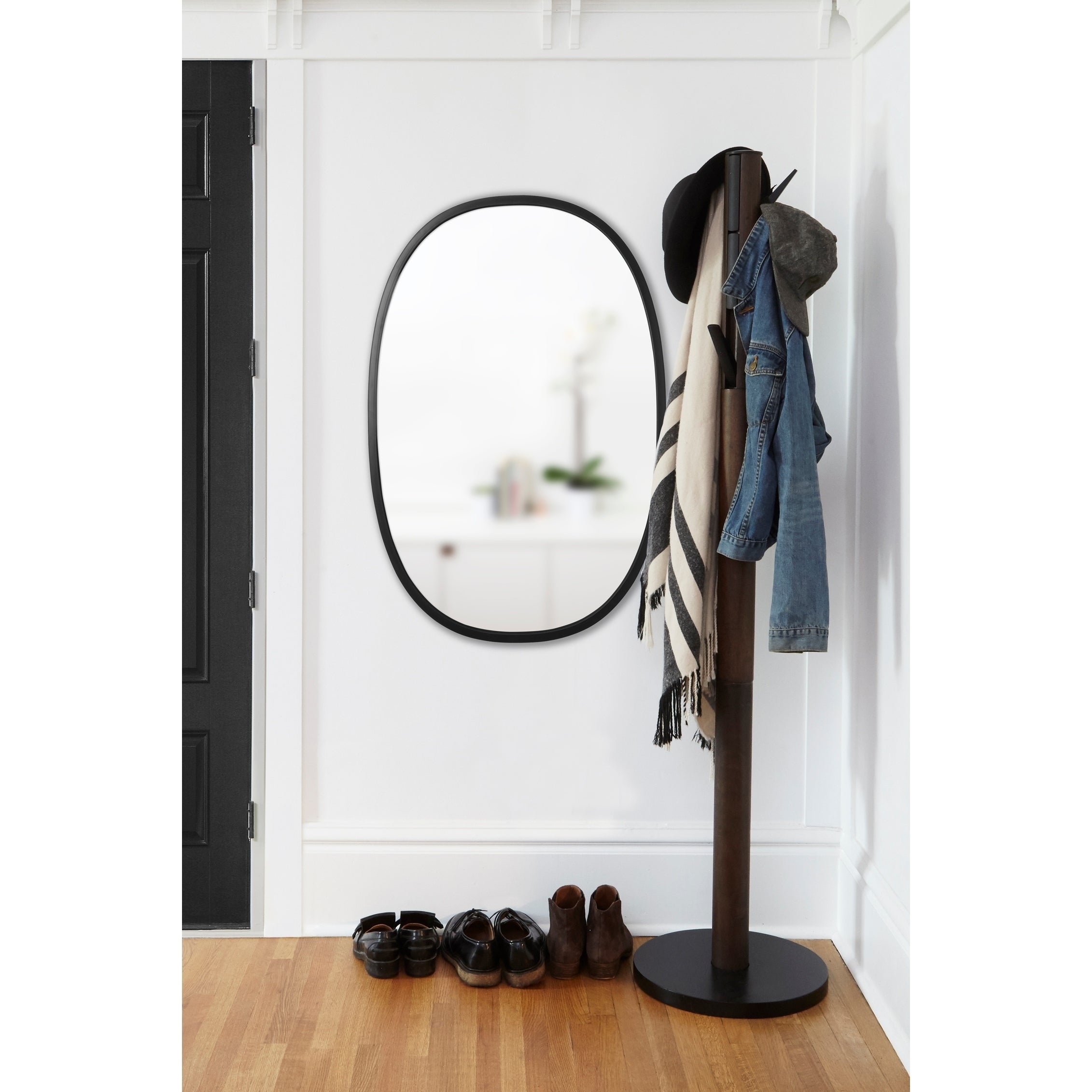 Umbra Hub Mirror Black Oval 24 Inches X 36 Inches Pertaining To Hub Modern And Contemporary Accent Mirrors (View 23 of 30)