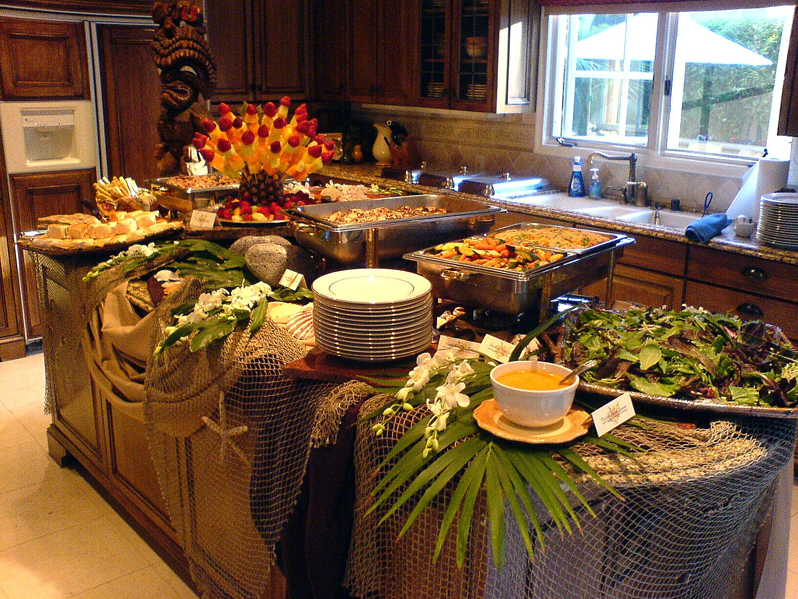 Love The Use Of Netting And Greens For This Luau Table (View 12 of 30)