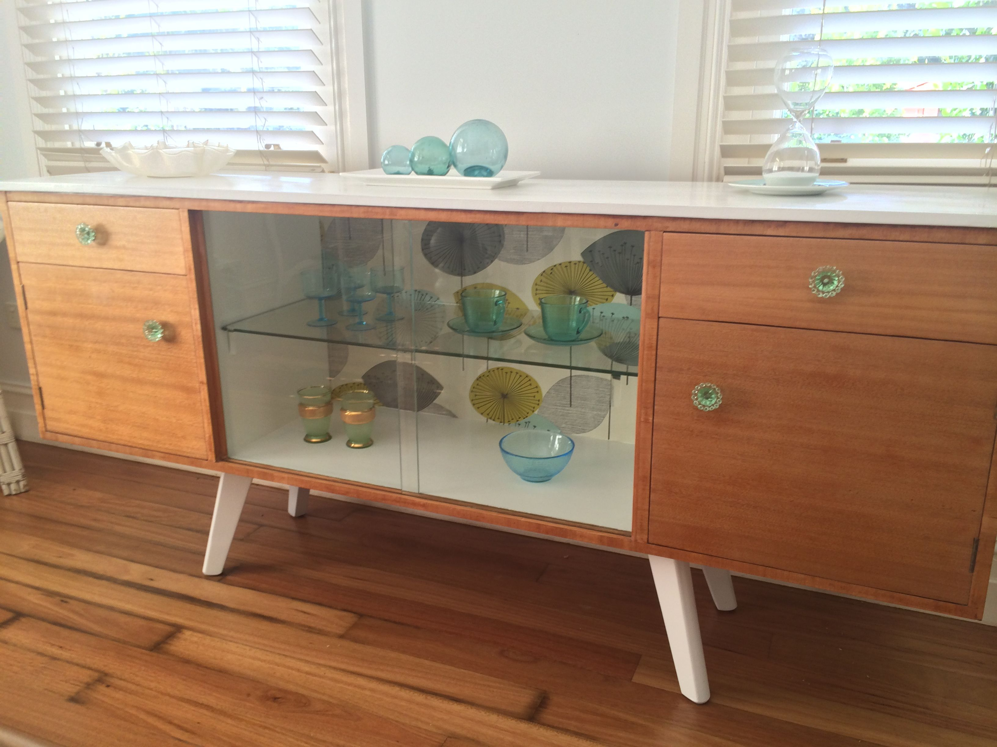 Mid Century Buffet With Iconic Dandelion Clocks Wallpaper For Mid Century White Buffets (View 8 of 30)