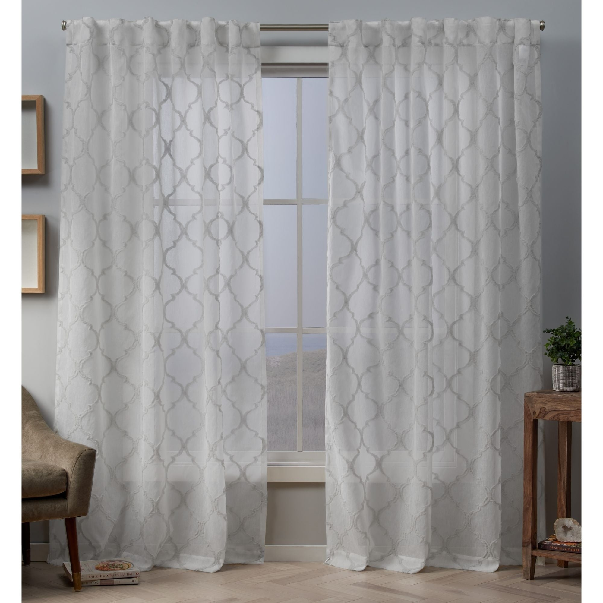 Copper Grove Botevgrad Embellished Sheer Top Curtain Panel Pair With Hidden Tab Within Laya Fretwork Burnout Sheer Curtain Panels (View 11 of 20)