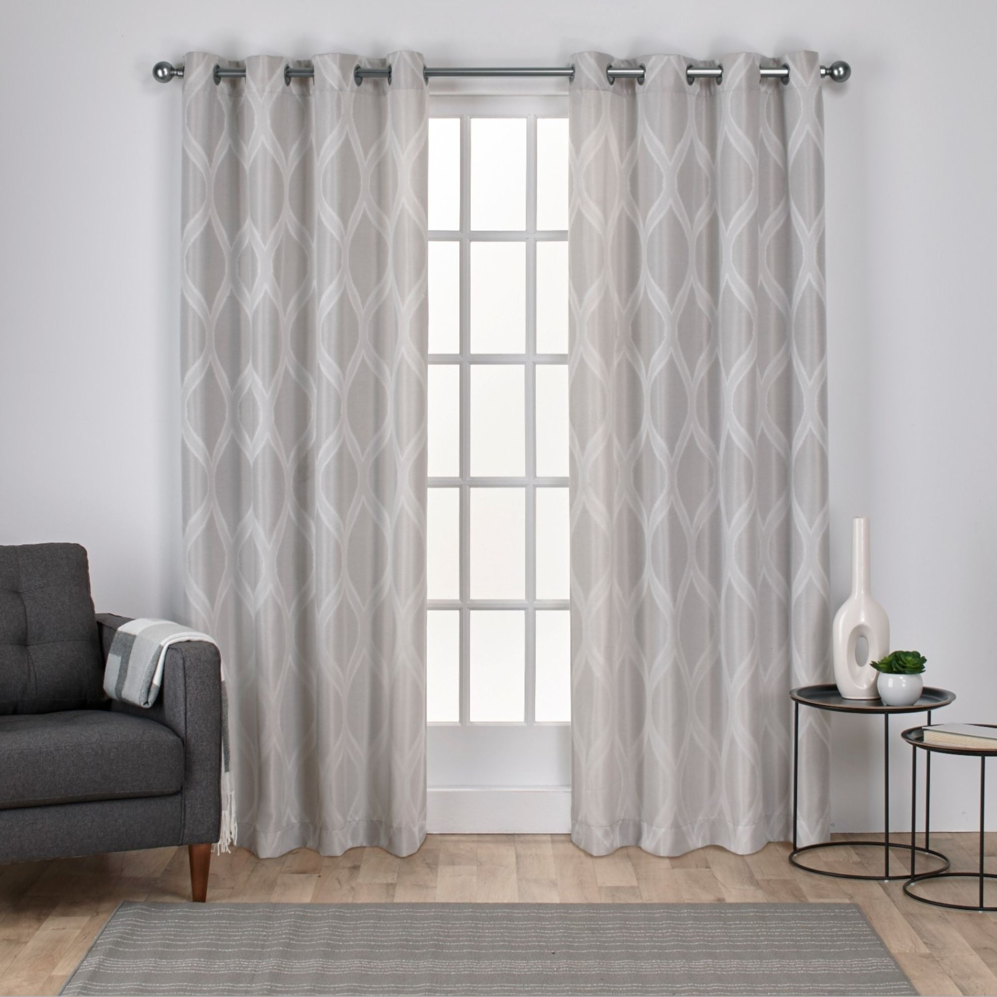 The Curated Nomad Carlton Jacquard Grommet Top Curtain Panel Pair Throughout The Curated Nomad Duane Jacquard Grommet Top Curtain Panel Pairs (View 5 of 30)